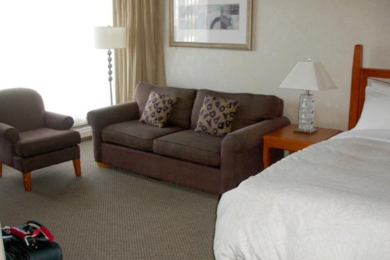 Chateau Victoria Hotel and Suites: living area with a desk (not shown) across sofa