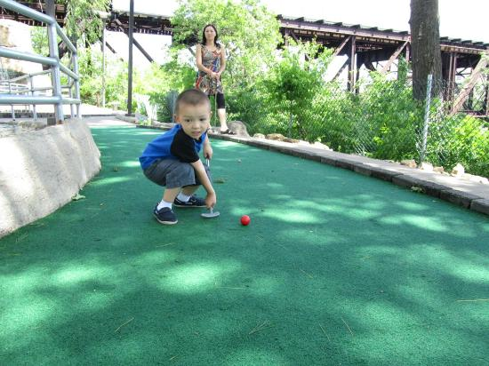 Timber Falls Adventure Golf: Is he really playing golf or something else?