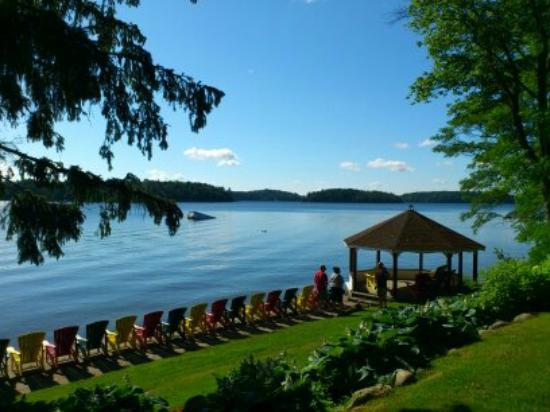 Clevelands House colourful Muskoka chairs & gazebo to soak in view of Lake Rosseau. (Clevelands