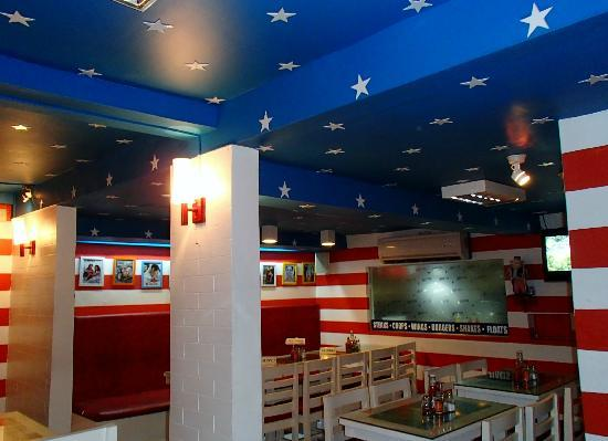Uncle Sam Restaurant: Big screen TV & icon pictures.
