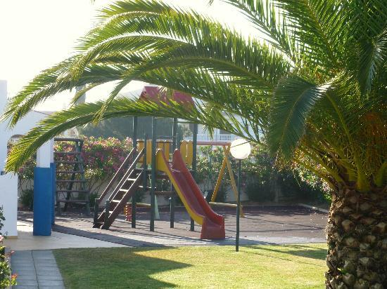 Joinal Villas Apartments: Children's play area with climbing frame and swings
