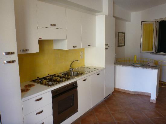 Residence degli Agrumi: Kitchen area/Laundry in cupboard