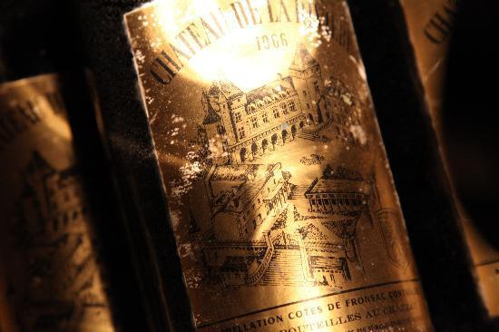 Chateau de la Riviere: underground wine cellar old bottles