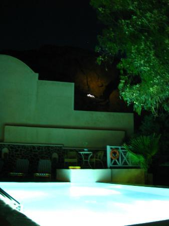 Evizorzia Villas: pool with view of illuminated church in mountain