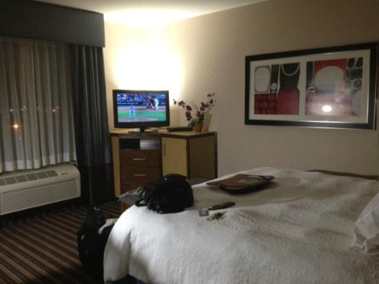 Hampton Inn Jackson- Flowood: TV stand near window. Fridge below.