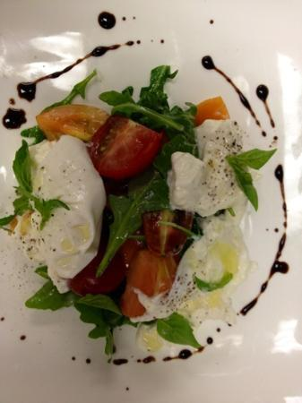 Periwinkle: Burrata with heirloom tomatoes and arugula.