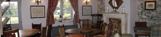 Relax by the fire at the Elveden Inn