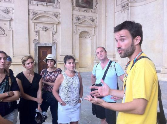 Discover Prague Tours : Informing about a nice building full of sculpture.