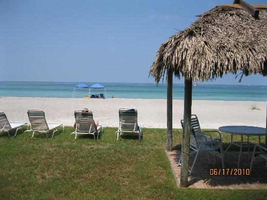 The Diplomat Condominium Beach Resort: The tiki hut and beach chairs just before the beach and magnificent beach.