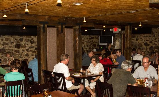T-Dub's Public House: Dining room featuring original field stone, posts and beams