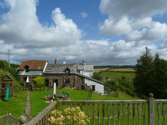 Robin Hill Farm Cottages: view of the cottages from the decking area