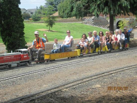 Medford Railroad Park: another train full of riders passes near the sttion