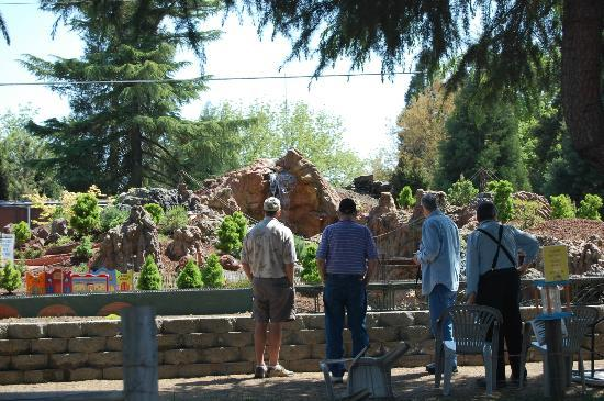 Medford Railroad Park: people checking out the garden railroad