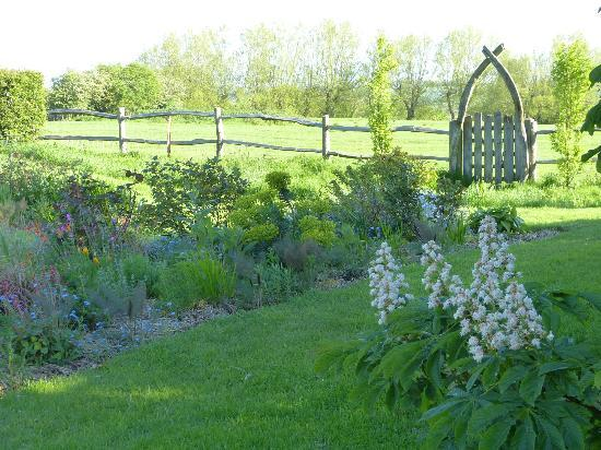 Boonshill Farm: Back garden with two rows of planted beds overlooking fields
