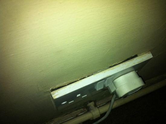 The Spotted Cow: PLUG SOCKET HANGING OFF WALL