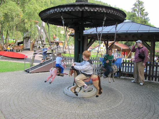 Märchenpark Marquarstein: The running track is in the left,background. Someone gets the workout, another gets a ride.