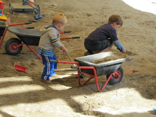 Märchenpark Marquarstein: Sand pit with small wheel barrows, construction hats, building blocks, etc. It's a work site!