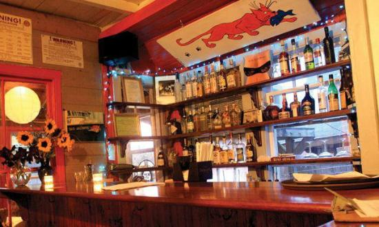 The Red Cat Kitchen at Ken N' Beck: our beautiful cozy bar- perfect for a low-key night out.