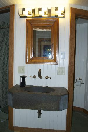 Stone Quarry House: Tower Cottage Sink with Shower on Left and Toilet Closet on Right