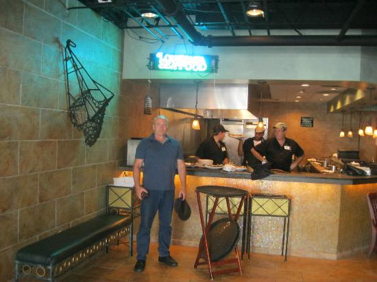 Drago's Seafood Restaurant: At the Oyster shucking carousel