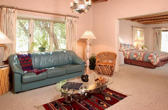Taos Country Inn: Spacious rooms with sitting areas and fireplaces (pictured: the Alexis).