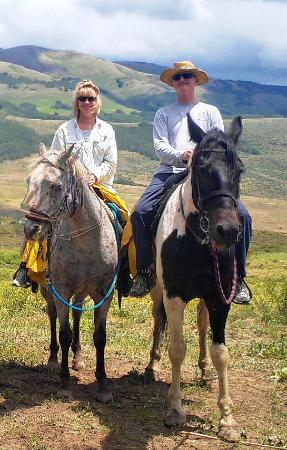 Fantasy Ranch Outfitters : My husband and me - enjoying Comanche and Merlin on our ride.