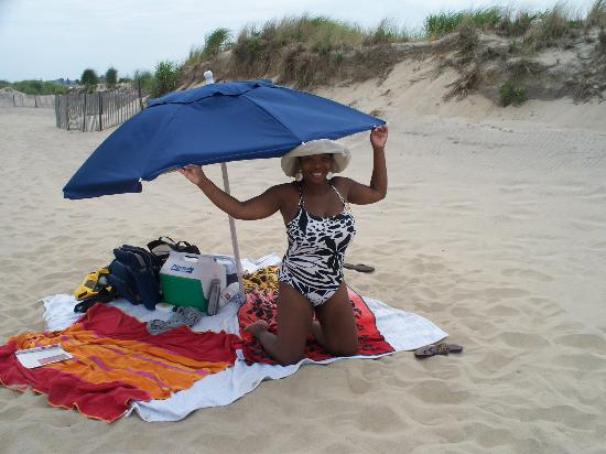 The Sandcastle Inn: Under the complimentary umbrella, very private by the dunes