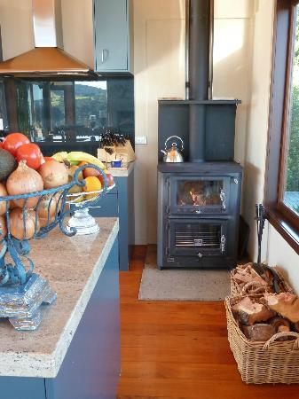 Ti Point Retreat: Wood burner in kitchen