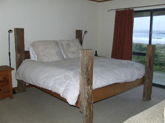Curio Bay Accommodation: Bed at the studio