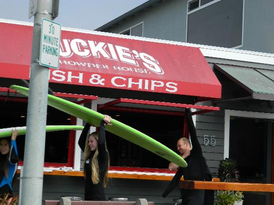 Duckie's : Surfers crossing restaurant on way to beach