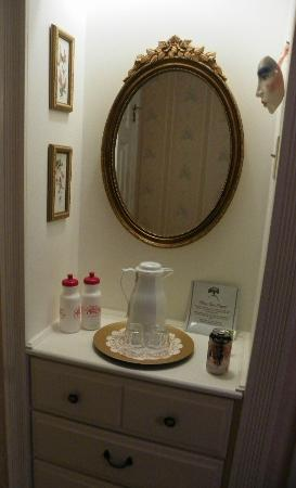 Arsenic and Old Lace Bed & Breakfast Inn: vanity area in room with carafe