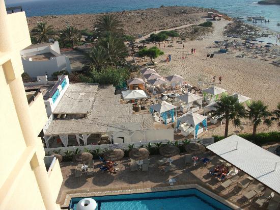 Tasia Maris Sands Beach Hotel: View from room of bar next door and beach area