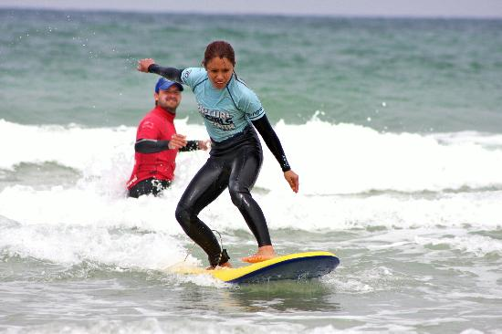 Dolphin Surf School: Proud teacher on the background. hahaha