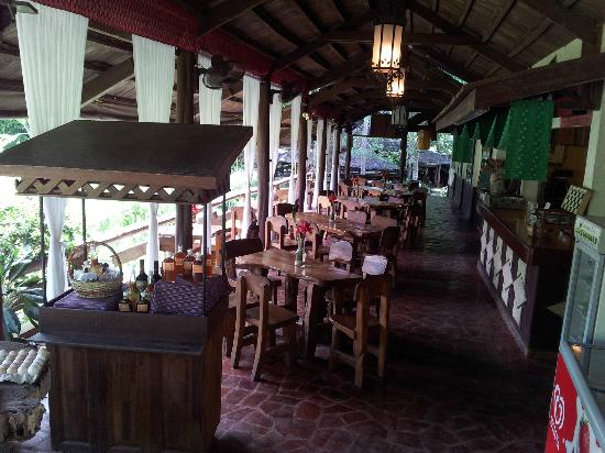 Malagos Garden Resort: The View Deck, relaxing bar with funky handmade tables and chairs.