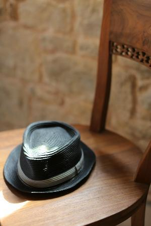 St Luke Residence: My husband's hat & the beautiful chair.