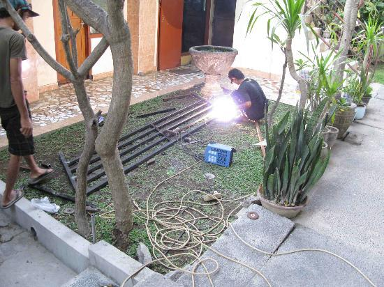 Sayang Maha Mertha: welding in front of terraces of