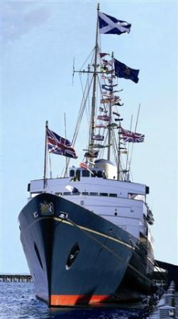 HMY Britannia: Royal Yacht Britannia, now berthed in Edinburgh, with her dress flags flying in the wind.