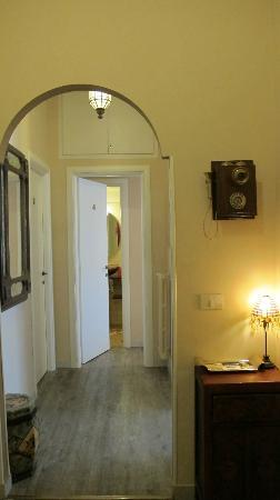 Campanella3: The hallway of the apartment, with a nice old phone and a small table