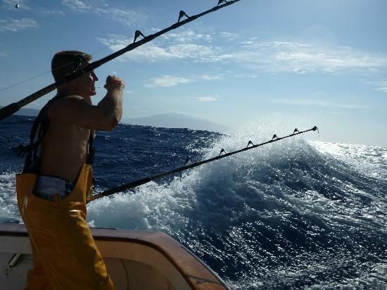 Wife and i with ahi picture of extreme sport fishing for Maui sport fishing