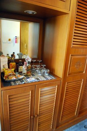 Empress Hotel Mini bar fridge is in cabinet below items on top. & Mini bar fridge is in cabinet below items on top. - Picture of ...