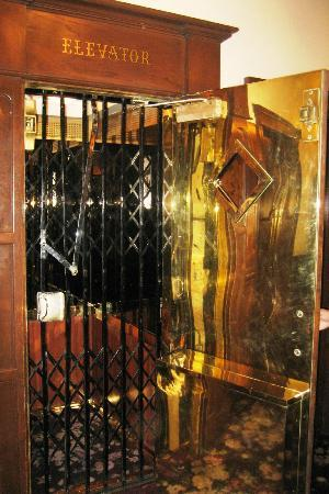 General Palmer Hotel: The elevator - heavy brass door to hold open, gate to open