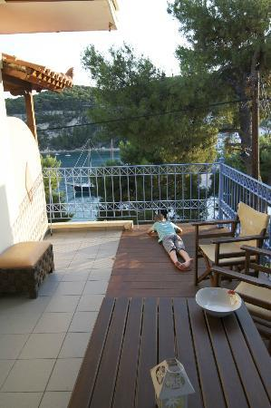 Nina Pansion: Terrace, perfect to relax and read in the evening as my son does on the oicture.