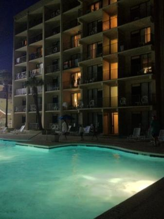 Econo Lodge Inn & Suites Beach: Comfort Inn & Suites at night by the outdoor pool.