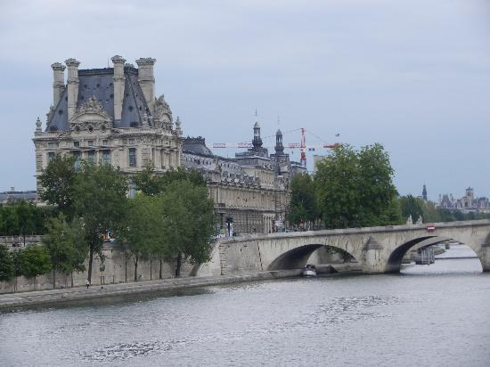Hotel d'Orsay - Paris: View from bridge one block from hotel. The Louvre across the river