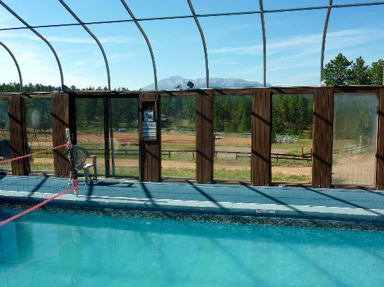 Triple B Ranch: This is the view from the pool. The blue sky and Pikes Peak make the water even better.