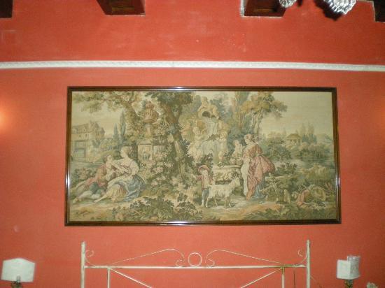 B&B Il Palazzo Vecchio : Arazzo sopra il letto