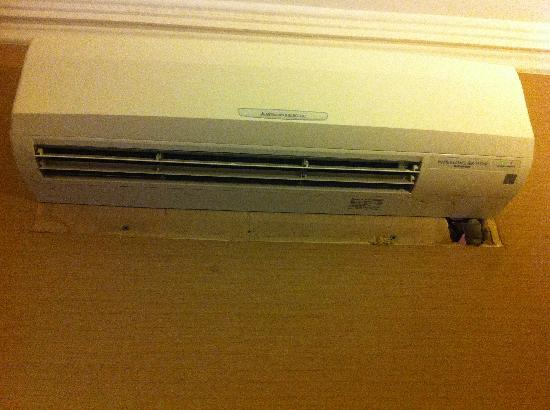 The Academy: A/C unit (failed to patch the wall)