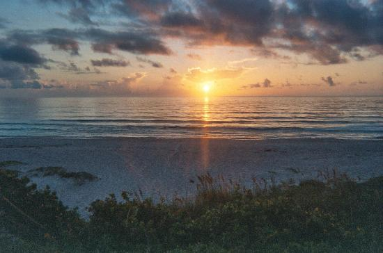 Tuckaway Shores Resort: the sun coming up over the beach from our balcony