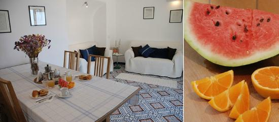Roomswithview: Living room and fresh fruit.