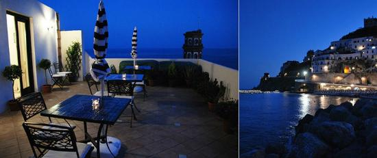 Roomswithview: Terrace and view of the beach by night.